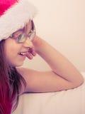 Little girl looking like santa elf. Stock Photos