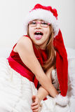 Little girl looking like santa elf. Royalty Free Stock Photos