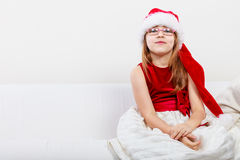 Little girl looking like santa elf. Royalty Free Stock Photography