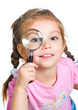 Little girl looking through a magnifier Stock Images
