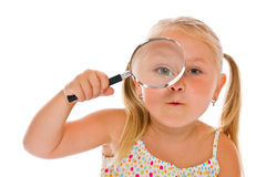 The little girl looking through a magnifying glass Royalty Free Stock Images