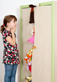 Little girl looking into a messy closet Royalty Free Stock Photo