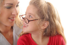 Little girl looking at mom with glasses. Shot of a little girl looking at mom with glasses Royalty Free Stock Image