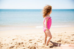 Little girl looking at the ocean Royalty Free Stock Image