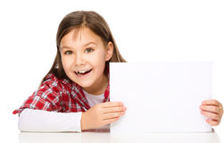 Little girl is looking from out blank board Stock Image