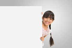 Little girl looking out of the blank sheet Stock Image