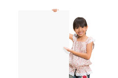 Little girl looking out of the blank sheet Royalty Free Stock Photos