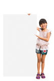 Little girl looking out of the blank sheet Stock Photography