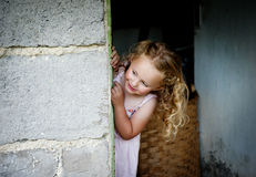 Little girl by the door Stock Photo