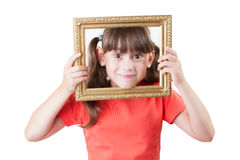 Little girl looking out of picture frames Royalty Free Stock Photos
