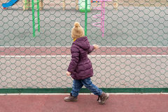 Little girl looking at the playground Royalty Free Stock Image