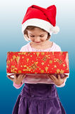 Little girl looking in present box Stock Photos