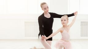 Little girl looking at professional ballet dancer stock photos