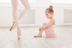 Little girl looking at professional ballet dancer Royalty Free Stock Image
