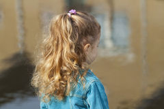Little girl looking at river. Stock Photo