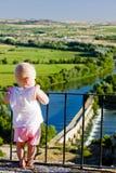 Little girl looking at Roman bridge Royalty Free Stock Photos