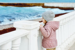 Little girl looking on the sea. Little girl is looking on the sea Royalty Free Stock Photography