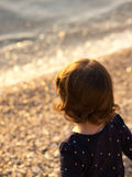 Little girl looking at the sea Stock Photos