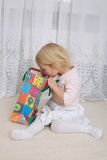 Little girl looking into the shopping bag Royalty Free Stock Image