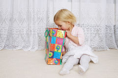 Little girl looking into the shopping bag Royalty Free Stock Photo
