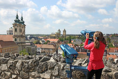 Little girl looking through sightseeing binoculars on Eger Royalty Free Stock Photos