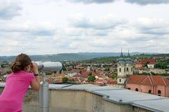 Little girl looking through sightseeing binoculars Royalty Free Stock Image
