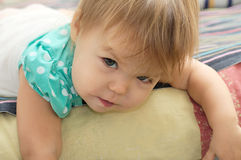 Little girl looking slyly Royalty Free Stock Image