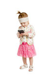 Little girl looking at a smartphone Stock Photos