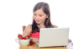 A little girl looking  the strawberries with envy Stock Photo