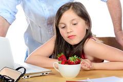 A little girl looking  the strawberries with envy Stock Images