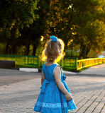 Little girl looking at the sunset Stock Photo