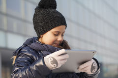 Little girl looking at tablet Stock Photos