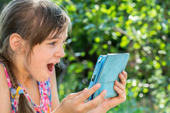 Little girl looking tablet Stock Image