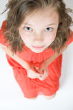 Little girl looking to the bottom Royalty Free Stock Photos