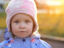 Little girl looking to the camera - serious neutral look Stock Images