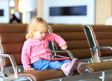 Little girl looking at touch pad in the airport Royalty Free Stock Photos
