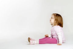 Little girl looking up. Little funny girl looking up Royalty Free Stock Images