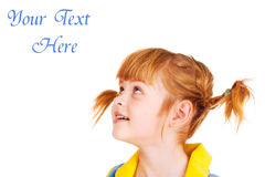 Little girl looking up. Portrait of a funny red haired little girl looking up Stock Images