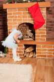 Little girl looking up fireplace Royalty Free Stock Photos