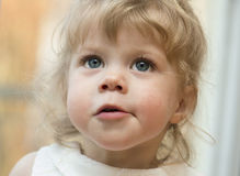 Little girl  looking up with her mouth open. Stock Photos