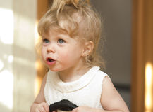 Little girl  looking up with her mouth open. Royalty Free Stock Photography