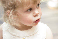 Little girl  looking up with her mouth open. Royalty Free Stock Photos