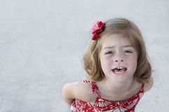 Little Girl looking upset Stock Images