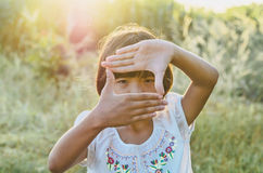 Little girl looking view and sunset Royalty Free Stock Images