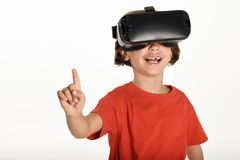 Little girl looking in VR glasses and gesturing with his hands. Royalty Free Stock Photography