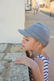 Little girl looking through a wall Stock Image