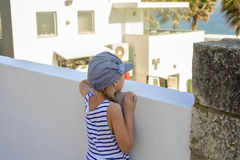 Little girl looking through a wall Royalty Free Stock Photo