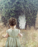 Little girl looking at white door Stock Photos