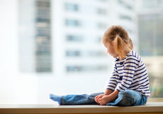 Little girl looking at window Stock Photography