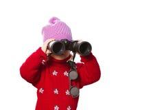Little girl  looks through binoculars. Royalty Free Stock Image